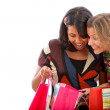 Women peeking at bags — Stock Photo #7730828