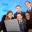 Stock Photo: Business team on a laptop
