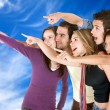 Friends pointing at the sky — Foto de Stock