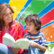 Stock Photo: Woman reading to her son