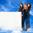 Heavenly women with banner — Stock Photo