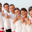 Friends at the beach with thumbs up — Foto de Stock