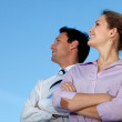 Business couple looking at the sky — Stock Photo #7731031