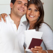 Travelling couple with passports — Stock Photo