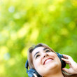 Woman with headphones outdoors - Stock Photo