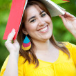 Royalty-Free Stock Photo: Woman with a book on her head