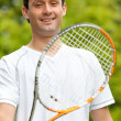 Stock Photo: Man with a racket