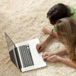 Women on the floor with a laptop — Stock Photo