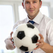 Business man with football — Stock Photo