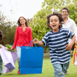Family with shopping bags outdoors — Stock Photo