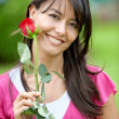 Woman with red rose - Stock Photo
