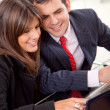 Business couple on a laptop — Stock Photo