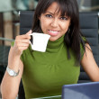 Business woman drinking coffee — Stock Photo