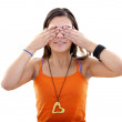 Woman covering her eyes - Stock Photo