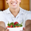 Man with a strawberries bowl - Stock Photo