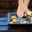 Woman&#039;s foot into water - Stockfoto
