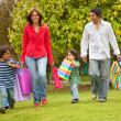 Happy family shopping - Stock Photo