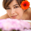 Woman potrait with a flower — Stock Photo