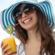 Summer woman with a hat and a drink — Stock Photo