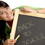 Woman writing back to school — Stock Photo