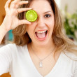 Woman with a lemon in her eye — Stock Photo #7731729