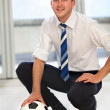 Business man with a football — Stock Photo