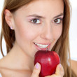 Woman portrait with a red apple - Stock Photo
