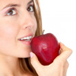 Woman eating a red apple - Stock Photo