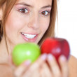 Woman staring at two apples — Stock Photo