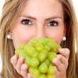 Royalty-Free Stock Photo: Woman with grapes isolated