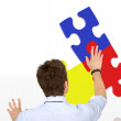 Business man with a puzzle - Foto Stock