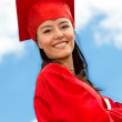Stock Photo: Graduated female in gown