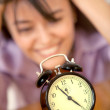Desperate woman staring at a clock — Stock Photo
