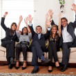 Stock Photo: Excited business group