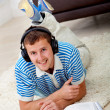 Man studying and listening to music — Stock Photo