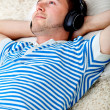 Relaxed man listening to music - Stock Photo