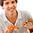 Man eating pizza — Stockfoto