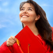 Stock Photo: Female graduate throwing mortarboard