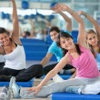 Stock Photo: In stretching class