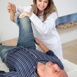 Stock Photo: Physiotherapist with a man