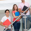 Group of students with folders — Stock Photo