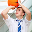 Business man throwing a basketball — Stock Photo #7732014