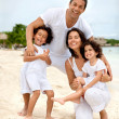 Stock Photo: Happy family at the beach