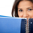 Woman covering with a notebook — Stock Photo #7732119
