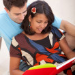 Loving couple reading - Stock Photo