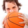 Man with a basketball - Stock Photo