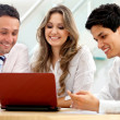 Stock Photo: Business team with a laptop