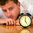 Stock Photo: Business man looking at a clock