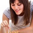 Girl playing chess - Stock Photo