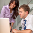 Business couple on a laptop — Stock Photo #7732261